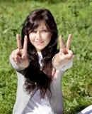 Brunette girl on green grass in the park. Stock Photos