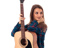 Brunette girl with guitar Stock Images