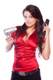Brunette girl with hair dryer Stock Photography