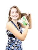 Brunette girl with hair spray Royalty Free Stock Photography