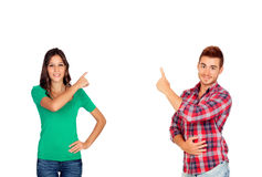 Brunette girl and a handsome boy pointing something Stock Image