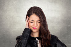Brunette girl with headache Stock Photo