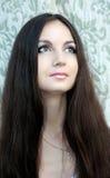 Brunette Girl. Healthy Long Hair. Beautiful Brunette Girl With Healthy Long Hair looks up Royalty Free Stock Image