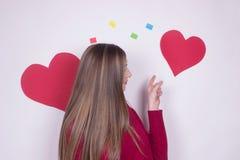Brunette girl heart positive love. Brunette teen young girl heart positive love isolated on white royalty free stock images