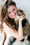 Brunette girl and her  cat over Royalty Free Stock Photo