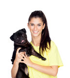 Brunette girl with her pug dog Royalty Free Stock Photography
