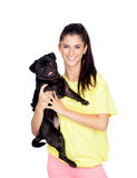 Brunette girl with her pug dog Stock Photos
