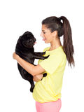 Brunette girl with her pug dog Stock Image