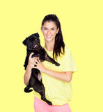 Brunette girl with her pug dog Stock Images