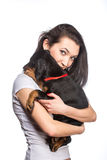 Brunette girl with her puppy isolated on white background Stock Image