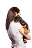 Brunette girl with her puppy isolated on white background Stock Photos