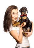 Brunette girl with her puppy isolated on white background Royalty Free Stock Image
