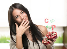 Brunette Girl Holding A Pomegranate In Kuhne Stock Images