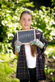 Brunette girl holding chalkboard with word Royalty Free Stock Images