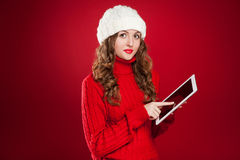 Brunette Girl Holding Ipad Touchs Screen Stock Photography