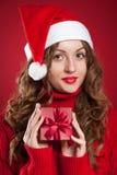 Brunette girl  holding little Christmas present Stock Image