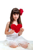 Brunette girl holding red heart in her hands Stock Photos