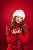 Brunette girl holding three red christmas balls Stock Images