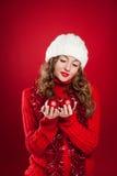Brunette girl holding three red christmas balls Stock Images