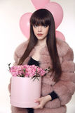 Brunette girl holiday portrait. Fashionable woman in pink fur co Royalty Free Stock Images