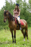 Brunette girl with horse Royalty Free Stock Photography