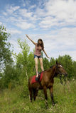 Brunette girl with horse Stock Photo