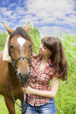 Brunette girl with horse Royalty Free Stock Photos
