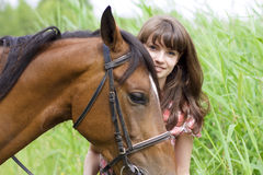 Brunette girl with horse Royalty Free Stock Images