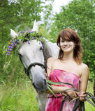 Brunette girl with horse Stock Photos
