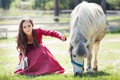 Brunette girl and horse Royalty Free Stock Image