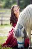 Brunette girl and horse Stock Photos