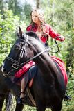 Brunette girl on horse Stock Image