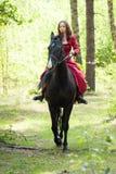 Brunette girl on horse Stock Photo