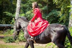 Brunette girl on horse Royalty Free Stock Photo