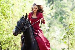 Brunette girl on horse Stock Images