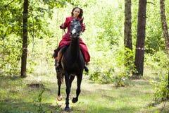 Brunette girl on horse Royalty Free Stock Image