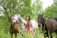 Brunette girl with horses Royalty Free Stock Photo