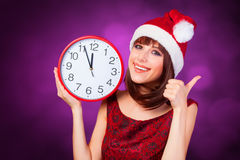 Brunette girl with huge clock Stock Photos