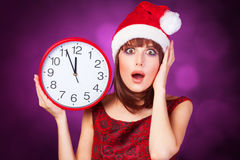 Brunette girl with huge clock Royalty Free Stock Images