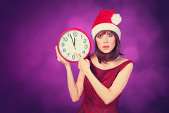 Brunette girl with huge clock Royalty Free Stock Image