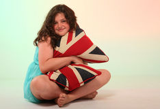 Brunette girl hugging pillow Royalty Free Stock Photos