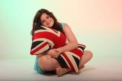 Brunette girl hugging pillow Stock Image