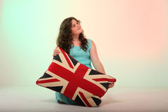 Brunette girl hugging pillow Royalty Free Stock Photography