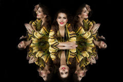 Brunette girl kaleidoscope mirror Royalty Free Stock Photos