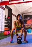 Brunette girl kettlebell swing weightlifting Royalty Free Stock Photo