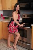 Brunette Girl Kitchen Stock Images