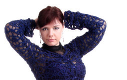 Brunette girl in lace dress puts hands behind head Stock Images