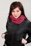 Brunette girl in leather jacket Stock Image