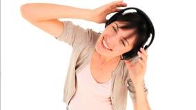 Brunette girl listening to music stock video
