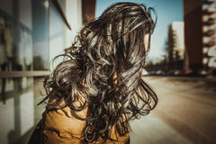 Brunette girl with long curly hair outdoor Royalty Free Stock Image